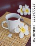 cup of dark tea on bamboo... | Shutterstock . vector #1326477236