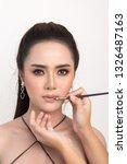 beautiful woman face. hand of... | Shutterstock . vector #1326487163