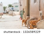 couple of chairs by house on... | Shutterstock . vector #1326589229