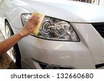 Stock photo hand with a wipe the car polishing 132660680