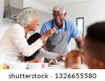 grandparents in kitchen with... | Shutterstock . vector #1326655580