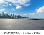 empty square with city skyline | Shutterstock . vector #1326731489