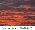 image of red sunset clouds.... | Shutterstock . vector #1326789620