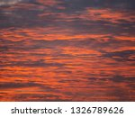 image of red sunset clouds.... | Shutterstock . vector #1326789626