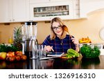 young blonde woman cooking in... | Shutterstock . vector #1326916310