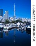 Toronto Yacht Club with beautiful blue lake and blue sky - stock photo