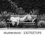 Homeless Person Asleep On A...