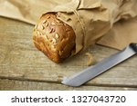a loaf of bread packed in paper ... | Shutterstock . vector #1327043720