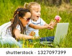 two children sit in park under... | Shutterstock . vector #1327097399