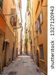 colorful narrow street in nice... | Shutterstock . vector #1327120943