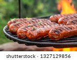 Delicious Sausage On Grill With ...