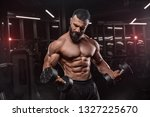 muscular man working out in gym ... | Shutterstock . vector #1327225670