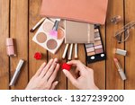 female hands doing nail polish... | Shutterstock . vector #1327239200