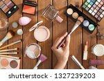 female makeup artist hand with... | Shutterstock . vector #1327239203