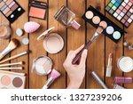 female makeup artist hand with... | Shutterstock . vector #1327239206