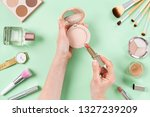 woman hand holding lipstick and ... | Shutterstock . vector #1327239209