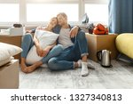 young family couple bought or... | Shutterstock . vector #1327340813