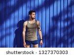 a man with a beard runner... | Shutterstock . vector #1327370303