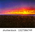 rainy sunset in the window | Shutterstock . vector #1327386749