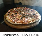 Hot Pizza On A Wooden Board...