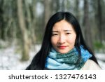 a chinese woman smiling at the...   Shutterstock . vector #1327476143
