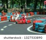 go kart racer on the track.... | Shutterstock . vector #1327533890