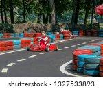 go kart racer on the track.... | Shutterstock . vector #1327533893