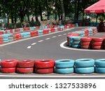 go kart racer on the track.... | Shutterstock . vector #1327533896