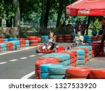go kart racer on the track.... | Shutterstock . vector #1327533920
