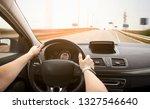 the woman driving the modern... | Shutterstock . vector #1327546640