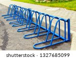 metal parking for bicycles. | Shutterstock . vector #1327685099