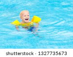 baby with inflatable armbands...   Shutterstock . vector #1327735673