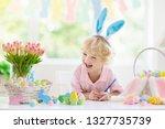 kids dyeing easter eggs....   Shutterstock . vector #1327735739
