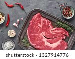 raw steak. meat with spices and ... | Shutterstock . vector #1327914776