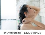 asian women bathing and she was ... | Shutterstock . vector #1327940429