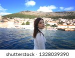 girl feel the adriatic sea in... | Shutterstock . vector #1328039390