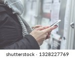 young woman uses a smartphone.... | Shutterstock . vector #1328227769