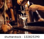 barman pouring wine from shaker ... | Shutterstock . vector #132825290