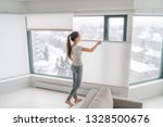 woman opening home curtains in... | Shutterstock . vector #1328500676