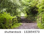A Wooden Gate On Path Leading...