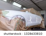 Stock photo the car after the accident in the camera for car body repair is partially covered with paper and 1328633810