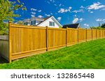 Long Wooden Cedar Fence.