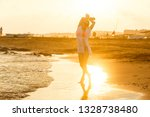 carefree woman dancing in the... | Shutterstock . vector #1328738480