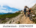 cycling woman and man riding on ... | Shutterstock . vector #1328745359
