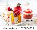 various mini cakes on a white... | Shutterstock . vector #1328806259