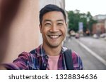 portrait of a smiling young... | Shutterstock . vector #1328834636