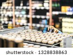 Retail Worker Filling Shelf...