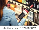 woman reading the label of red... | Shutterstock . vector #1328838869