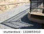 shadow of the forged fence on... | Shutterstock . vector #1328853410