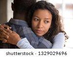 pensive young mixed race... | Shutterstock . vector #1329029696